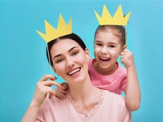 Mom and daughter with paper crowns